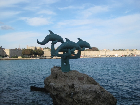 Statue of dolphins along the beach